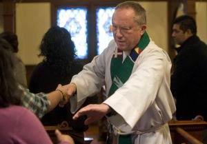 Father Karelius served Messiah Parish for 30 years. Photo: Ana Venegas, Orange County Register