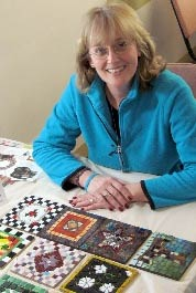 Mary Gilhuly with tiles created at the Institute.