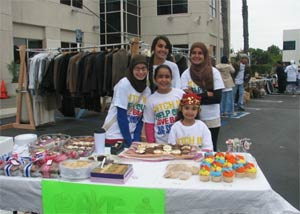 Young SARAH members in the parking lot of a local mosque selling beautiful cupcakes at a garage sale.