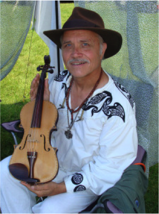 Rev. McCollum and his World Peace Violin – Photo: pncminnesota.com