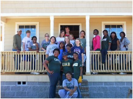 Students at the University of Alabama at Birmingham work to rebuild their community as part of the President's Interfaith and Community Service Campus Challenge. – Photo: whitehouse.gov