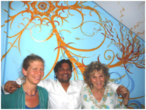Leora Sharone, Vikas Trapathi, and Ruth Sharone in front of the mural Leora painted for the Bhadri Kali Guest House.