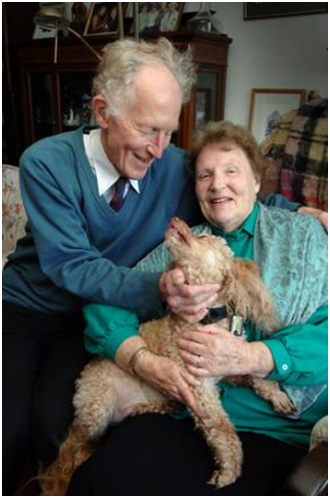 Marcus and Mary Braybroooke with their beloved poodle Toffy. – Photo: Oxford Mail