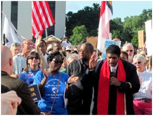 Rev. William Barber speaking at a Moral Monday gathering – Photo: Wikipedia, twbuckner