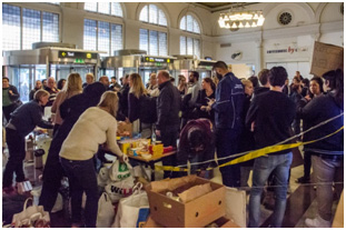 Syrian refugees being registered after arriving at a train station in Stockholm – Photo: Wikimedia Commons, Frankie Fouganthin