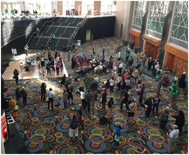 During the Parliament songs and drums from around the world rang out from a dozen sites in the Salt Palace convention center, and in the early morning sacred chanting and singing was piped throughout the facility. – Photo: TIO
