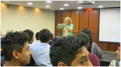 Ruth takes a photo of the full room attending her workshop on God and Allah Need to Talk (delivered in Spanish and English) at the Universal Dialogo Multicultural II in Guadalajara last month. – Photo: TIO