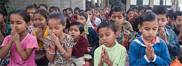 Morning interfaith prayer service – Photo: Manav Sadhna