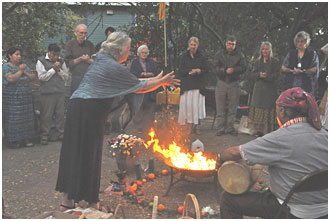 A fire ceremony led by Tata Apolinario, a Mayan shaman, on the right. – Photo: Greg Harder