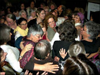 """A final 'hug' at the conclusion of the """"The Alchemy of Our Spiritual Leadership: Women Redefining Power"""" conference, April 2011 - Photo: Ruth Broyde Sharone"""