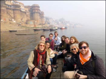 Professor Eck (l.) with students boating on the Ganges River at Varanasi during the Makar Sankranti festival – Photo: South Asian Institute at Harvard