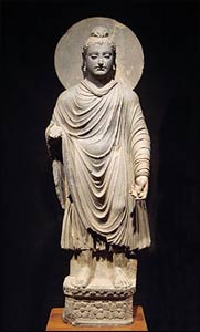 This Standing Buddha is in the Tokyo National Museum. Approximately 2,000 years old, it is one of the earliest known representations of the Buddha. – Photo: Wikipedia
