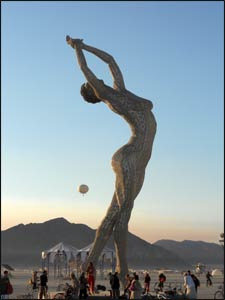 "The sheer size of ""Truth is Beauty"" by Marco Cochrane – you can see people wandering below the sculpture – gives a sense of the art objects at Burning Man."