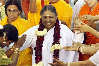 """Mata Amritanandamayi is known throughout the world as Amma, or Mother, or the """"hugging saint,"""" and is one of the rare 'gurus' with an active global presence today, engaged in massive social service work as well as hugging millions of followers. – Photo: Huffington Post"""