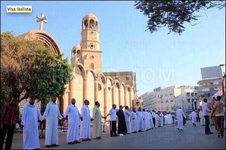 This photo of Muslim men protecting a Catholic Church in Egypt during mass was Tweeted by James Martin, SJ. He gave the photocredit to Will McHoebag, who doesn't know where it came from. That ambiguity adds an appropriate layer of confusion to the news coming from Egypt – good and bad – about religious minorities. See the first two stories below.