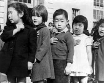 San Francisco public school students pledge allegiance to the American flag just prior to the internment of Japanese Americans in April 1942 – Photo: Wikipedia