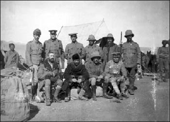 Younghusband (seated in the middle, with the fur coat and hat) travelling in China for the British government in 1904. Photo: Wikipedia