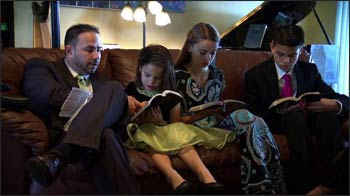 "Family Bible study at the Mongomery family, a still-shot from the documentary ""Families are Forever."