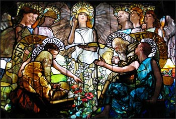"""Science and Religion are portrayed in harmony in this Tiffany window titled """"Education"""" (1890). Photo: Wikipedia"""