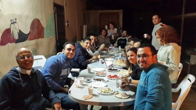 Worship and communal eating almost always accompany Melkite Catholic communities, this one in Jordan. – Photo: Catholics & Culture, Zaid Hadda