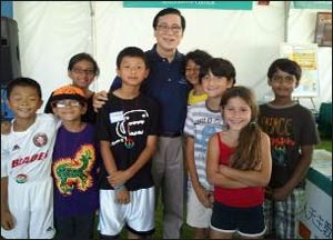 Mayor Sukyee Kang of Irvine, California, with First Drops performers at the Irvine Global Festival Village.
