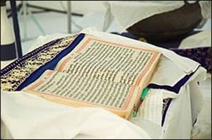 The holy Guru Granth Sahib is placed above the people in the Gurdwara. Photo: Wikipedia