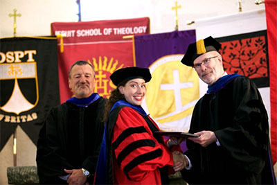 GTU Commencement Ceremony on May 7, 2015 held at Pacific Lutheran Theological Seminary. Pictured from the left are: Hal Leach, Chair of the Board of Trustees; Ashley Bacchi, Ph.D. student and winner of the Outstanding Dissertation Proposal in 2014; Riess Potterveld, GTU President.