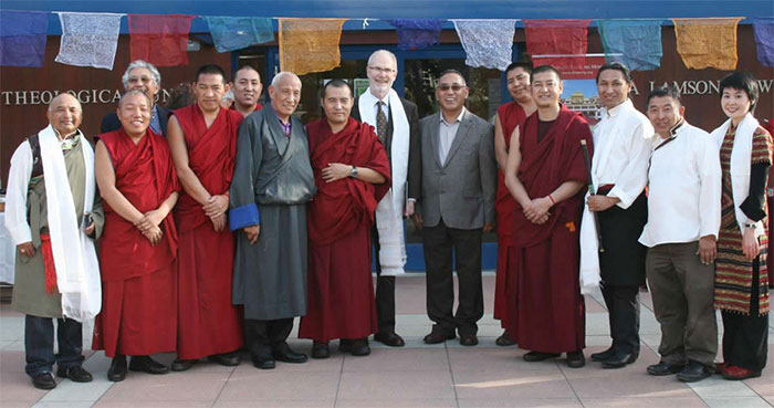 GTU President Riess Potterveld (center) with Venerable Thepo Rinpoche, the 8th Thepo Tulku (6th from left), and members of the Northern California Tibetan Community at an exhibition of Tibetan art and artifacts at Flora Lamson Hewlett Library at the Graduate Theological Union.