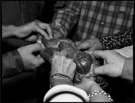 Shabbat is welcomed at Beit T'Shuvah, a halfway hourse for the treatment of alcohol, drug, sex, and gambling addictions, with the breaking of the traditional challah bread. Read the  story  in the review of Rich Nahmias' Golden States of Grace.