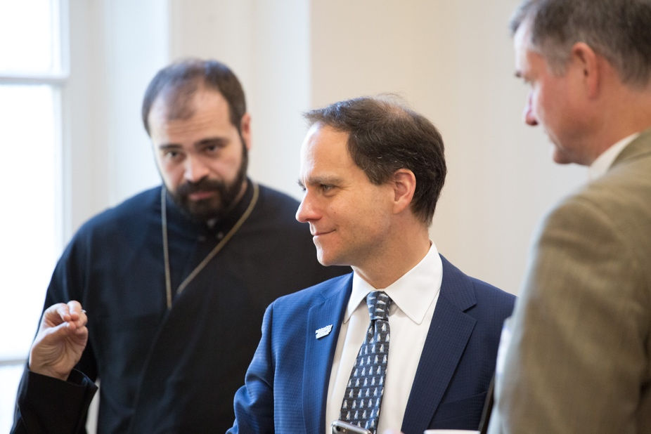 Dr. Nathanael Symeonides (Greek Orthodox Archdiocese of America), Rabbi Jonah Pesner (Union for Reform Judaism), and Rev. Fletcher Harper (GreenFaith) listen to one of their fellow participants talking about resistance.  – Photo: Steven D. Martin/National Council of Churches.