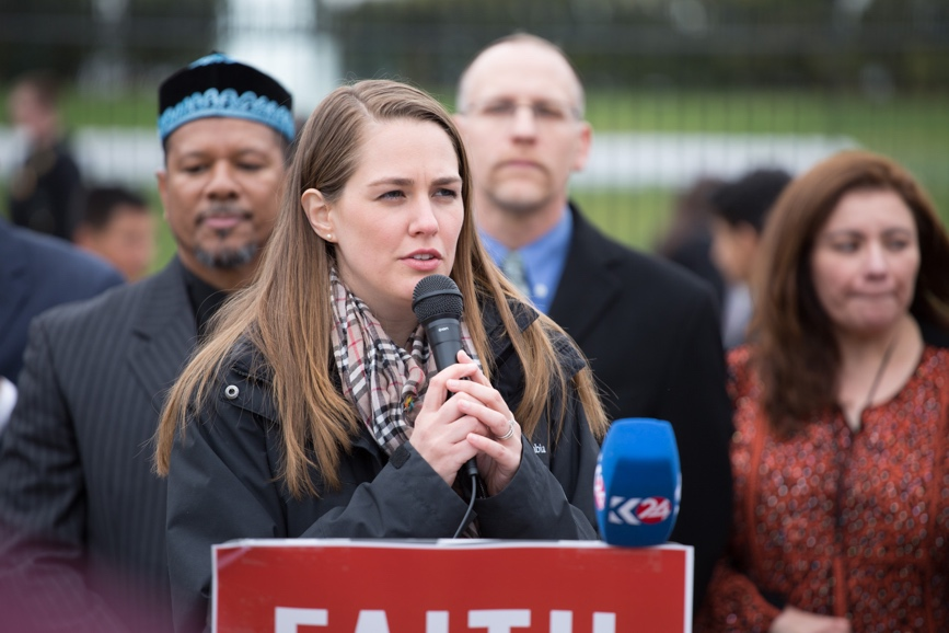Ms. Sari Heidenreich, North America regional coordinator of United Religions Initiative, speaks at a press conference in front of the White House, during Out of Many, One. – Photo: Steven D. Martin/National Council of Churches.