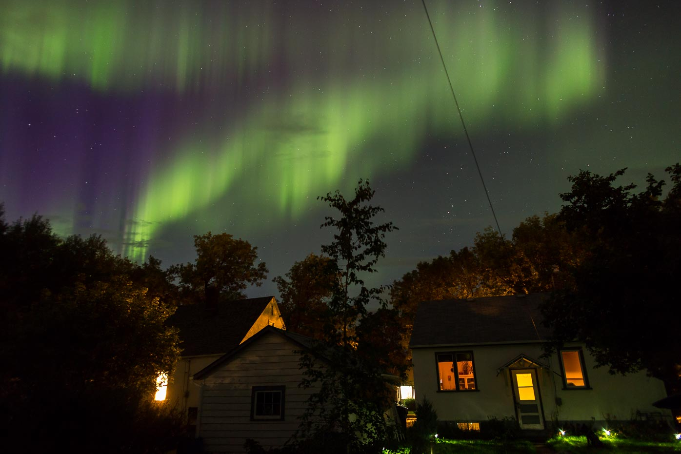 The Northern lights shining over the town of Dauphen – Photo:  Warren Justice