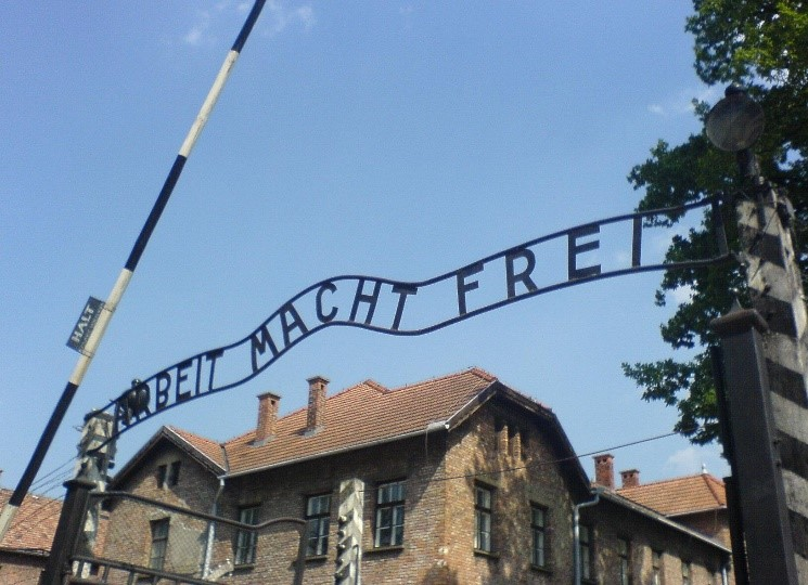"""Sign at the entrance of Auschwitz. The translation reads, """"Work makes you free."""" – Photo:    Wikipedia"""