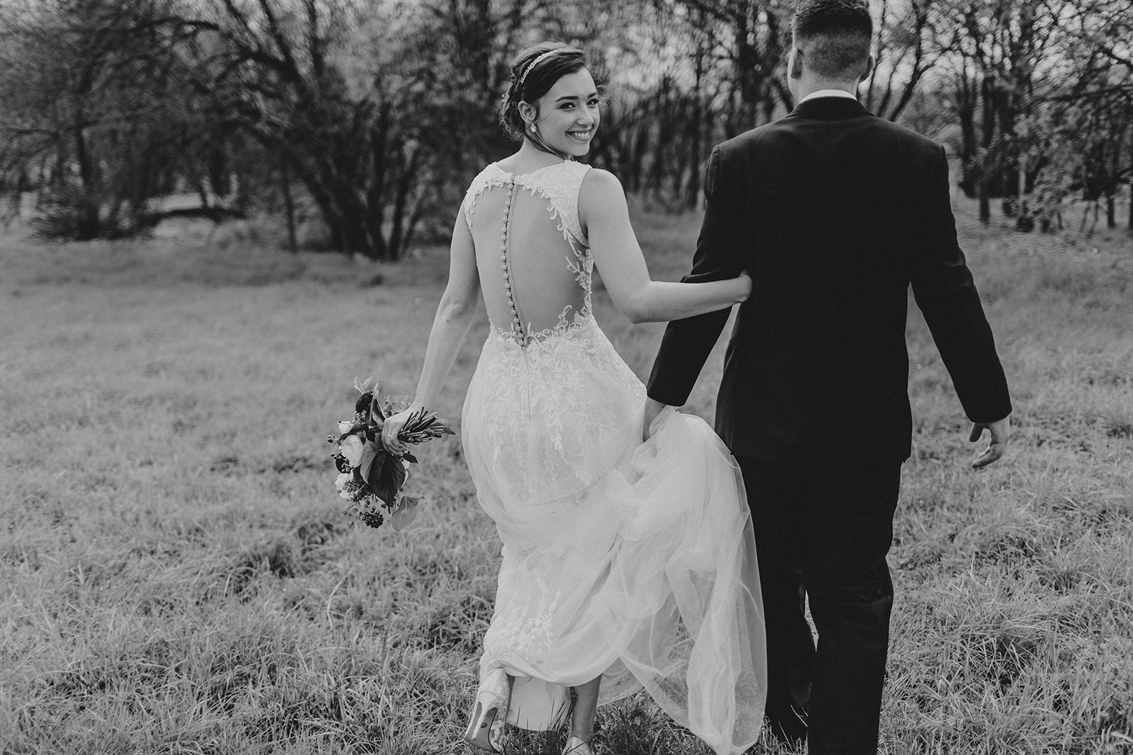 Bride and groom formals at a beautiful outdoor wedding in Austin Texas.
