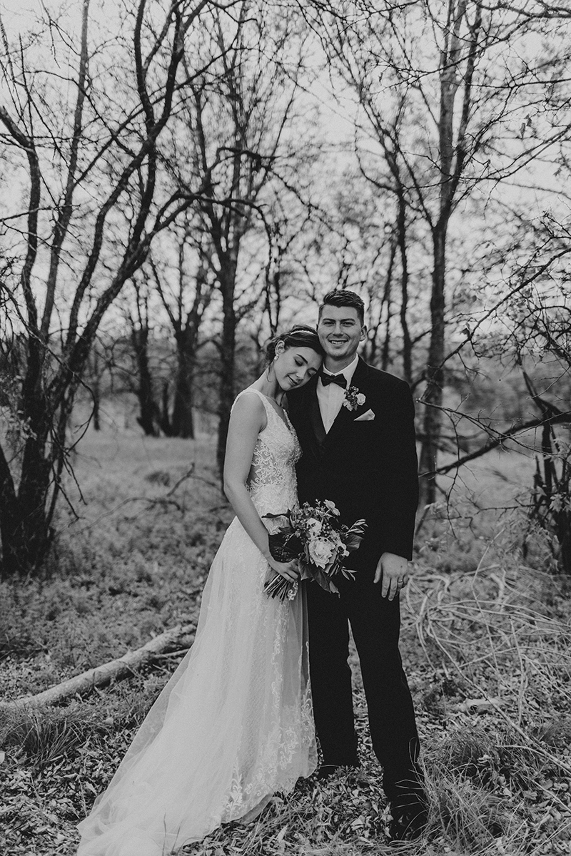 Bridal portraits with the bride and groom at a gorgeous outdoor wedding in Austin Texas.