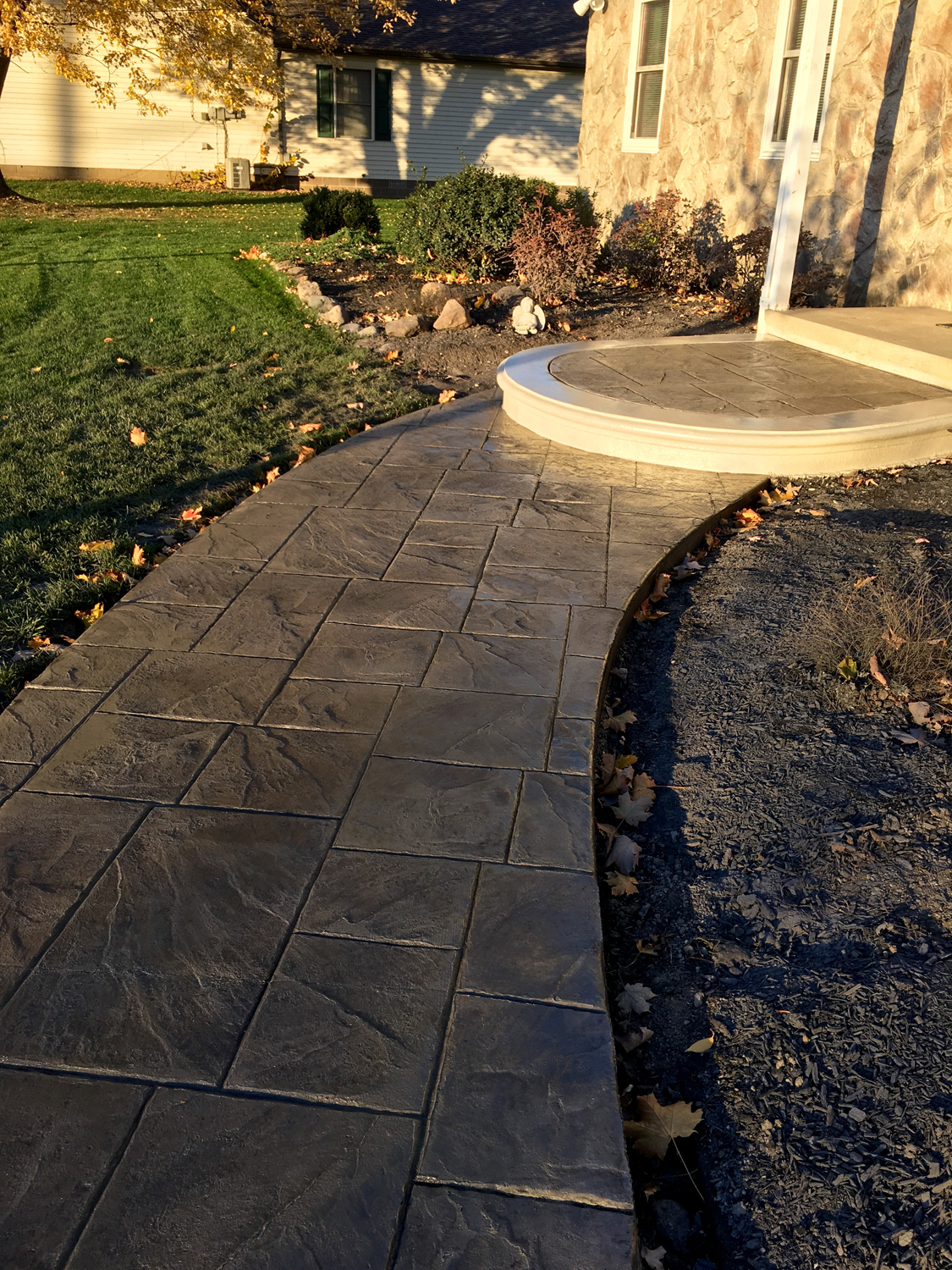 Large Ashlar Slate stamped walkway and landing w/ Slate integral color, Dark Gray release and Ash White color hardener for border and landing face.