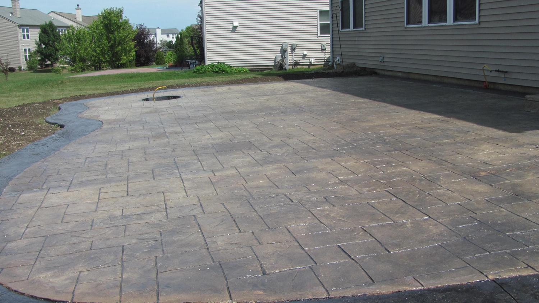 New patio. Brickforms Integral Adobe Buff Color, then Brickforms Antique Realease Medium Gray. We then used Brickforms Solvent Based Sealer Gem-Seal