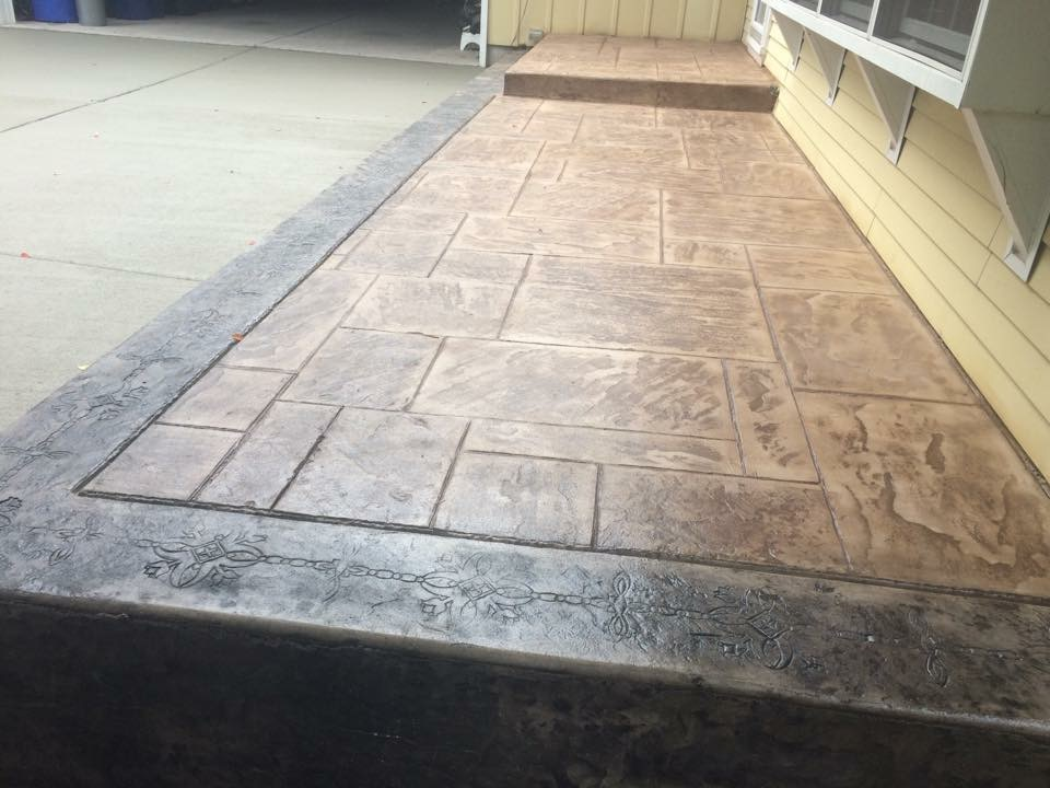 A small raised porch;  main color Golden Sandstone and Sandstone on a Grand Ashlar Slate stamp.  The border color is Stone Gray with Light Gray highlights.