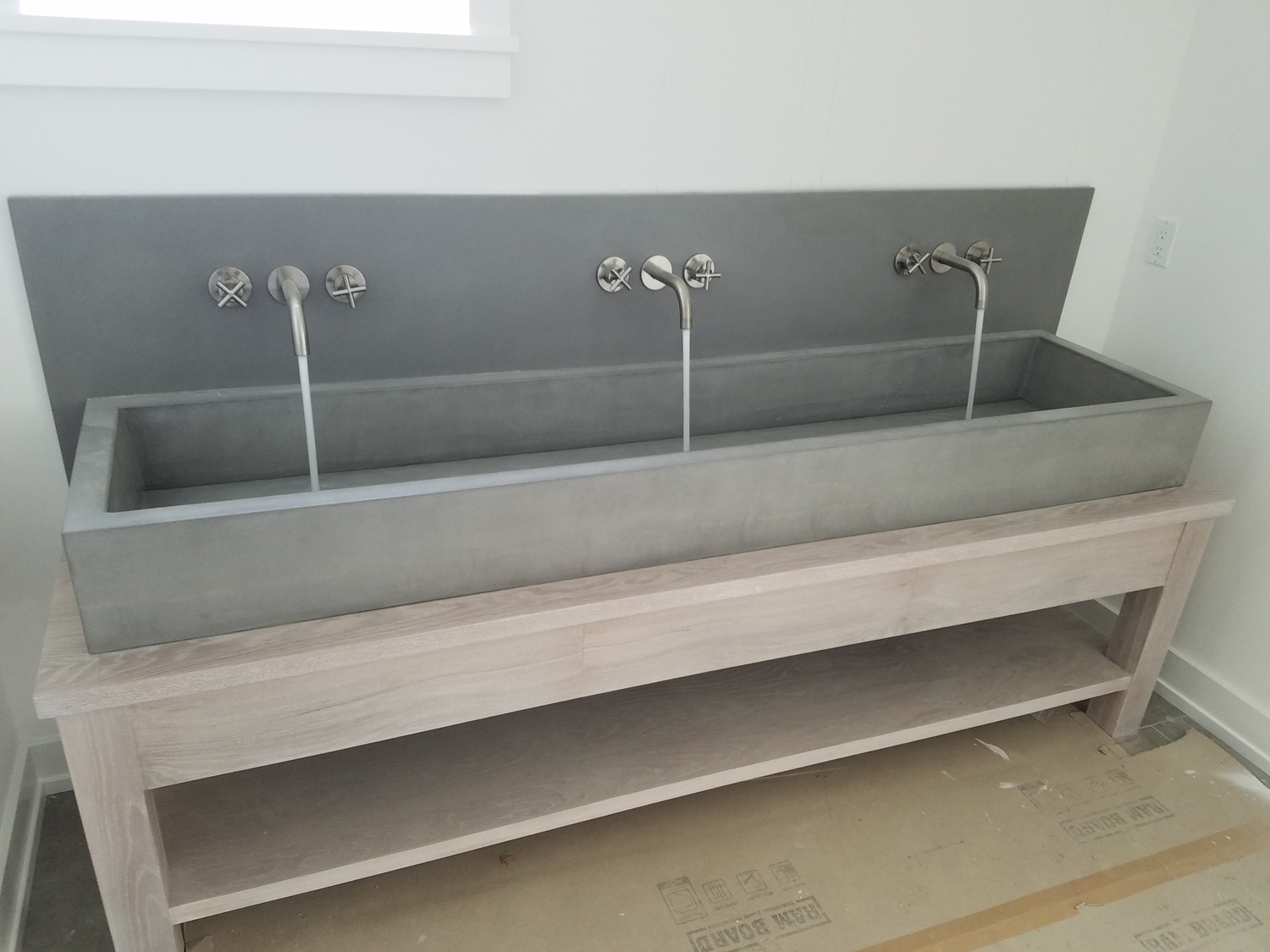 Integrally colored trough sink with backsplash