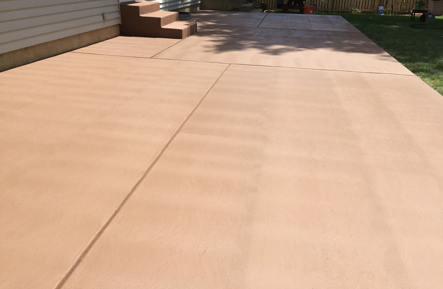 This is a colored concrete patio, using SGS Integral color #417. This project also included a new set of steps, which were poured separate. The consistency of SGS colors make them ideal for this type of project.
