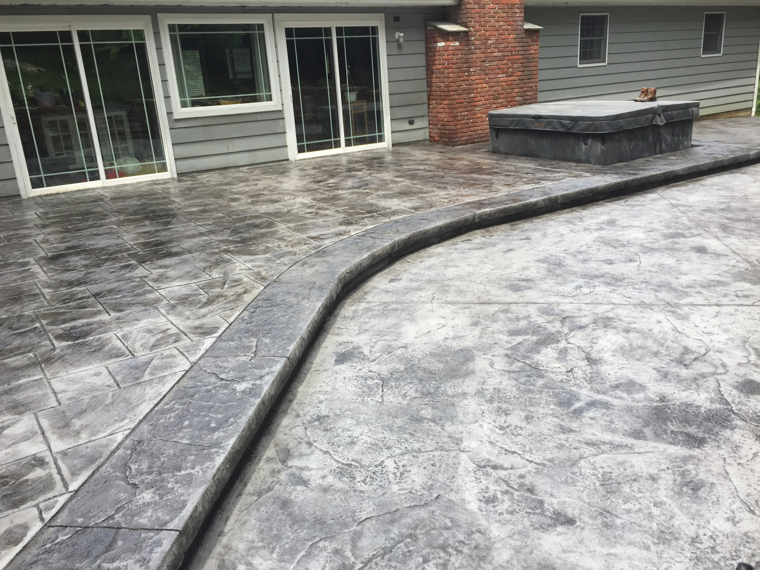 large asler slate with granite skins and boarder/ light gray hardener/ medium gray release/ brick form cure and seal