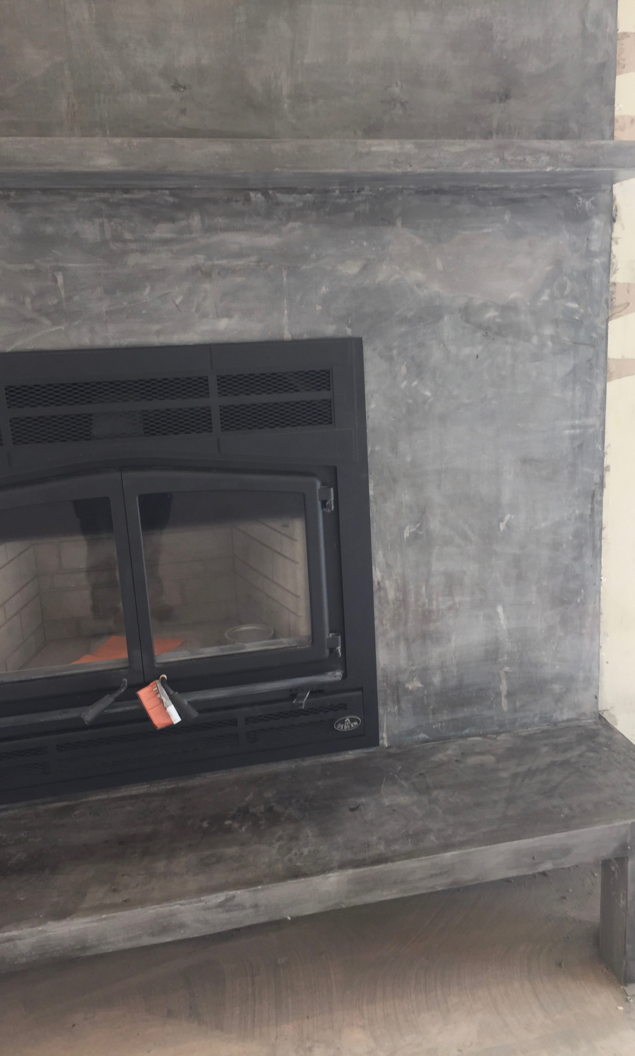 This is another photo of the fireplace with natural concrete.