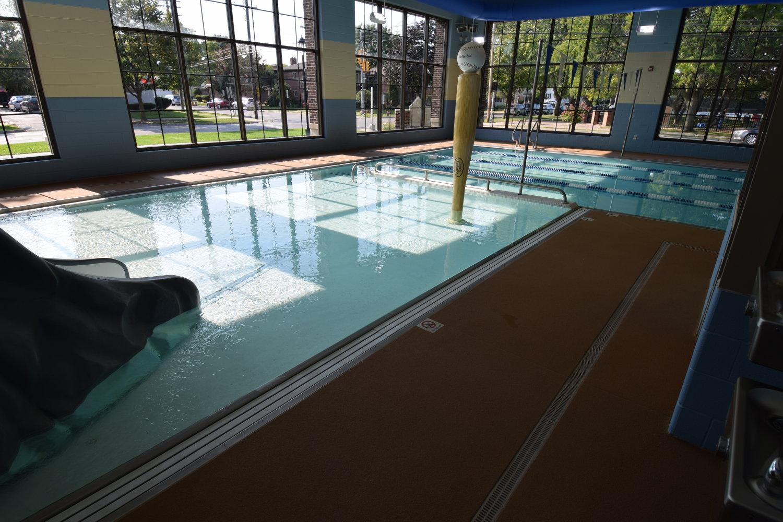 Integrally-Colored Spray Texture Indoor Pool Deck Cement Overlay. Brickform SM-Pro, MTC Overlay Liquid Colorant, MT 3000 Liquid Polymer, Decopoxy Sealer.