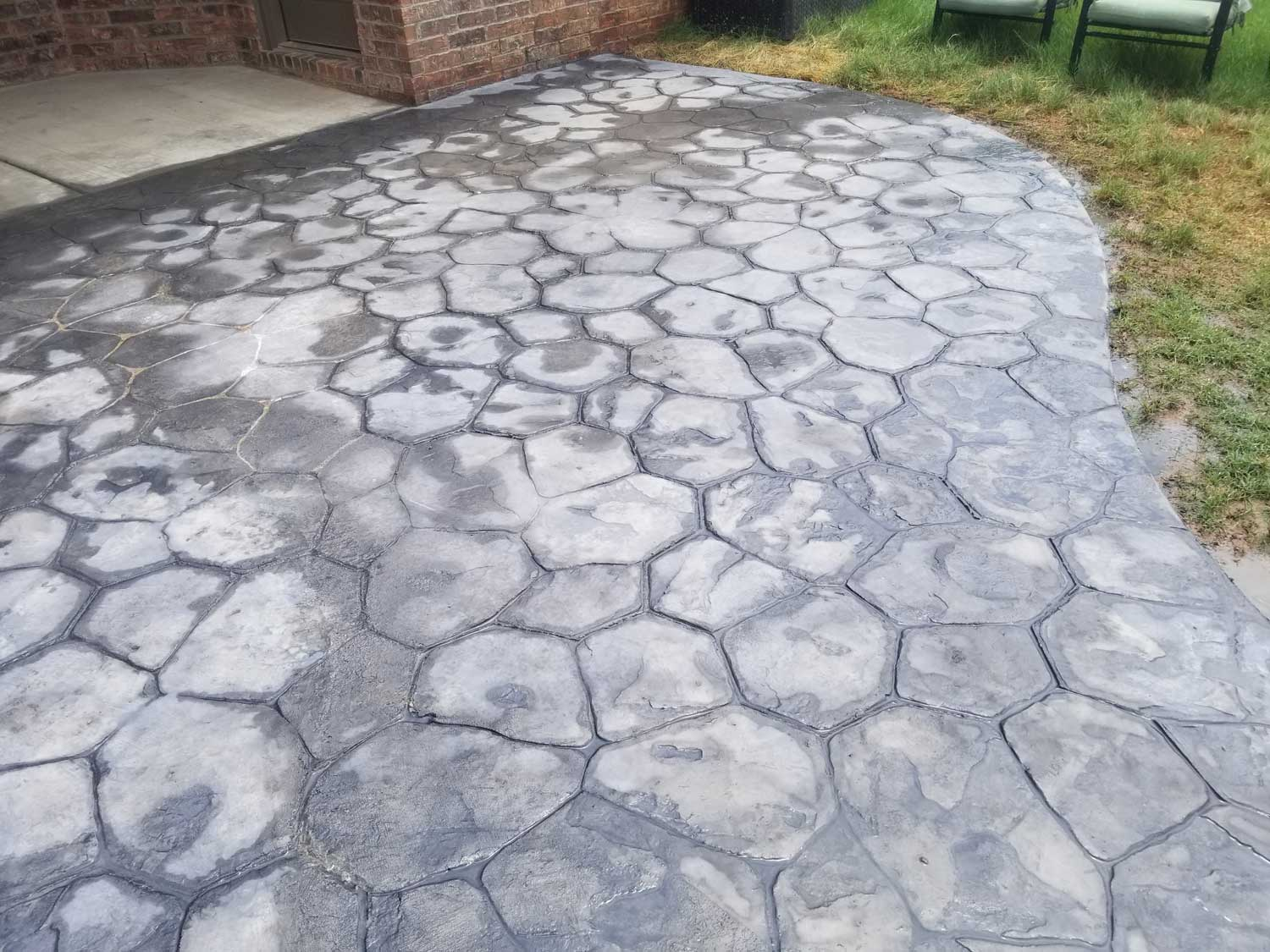We made sidewalk that came from the back entrance of the customers house that led to a shed. Random Stone stamps were used along with Storm Grey powdered Integral & Stone Gray Antique Release. on the picture we had not done the seal, but once we power washed some of the powder off we sealed it a clear coat.