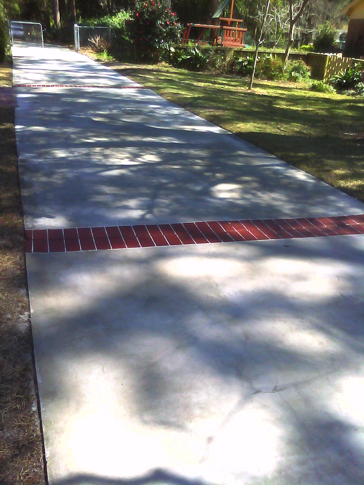 Complete driveway overlay with brick hand stained