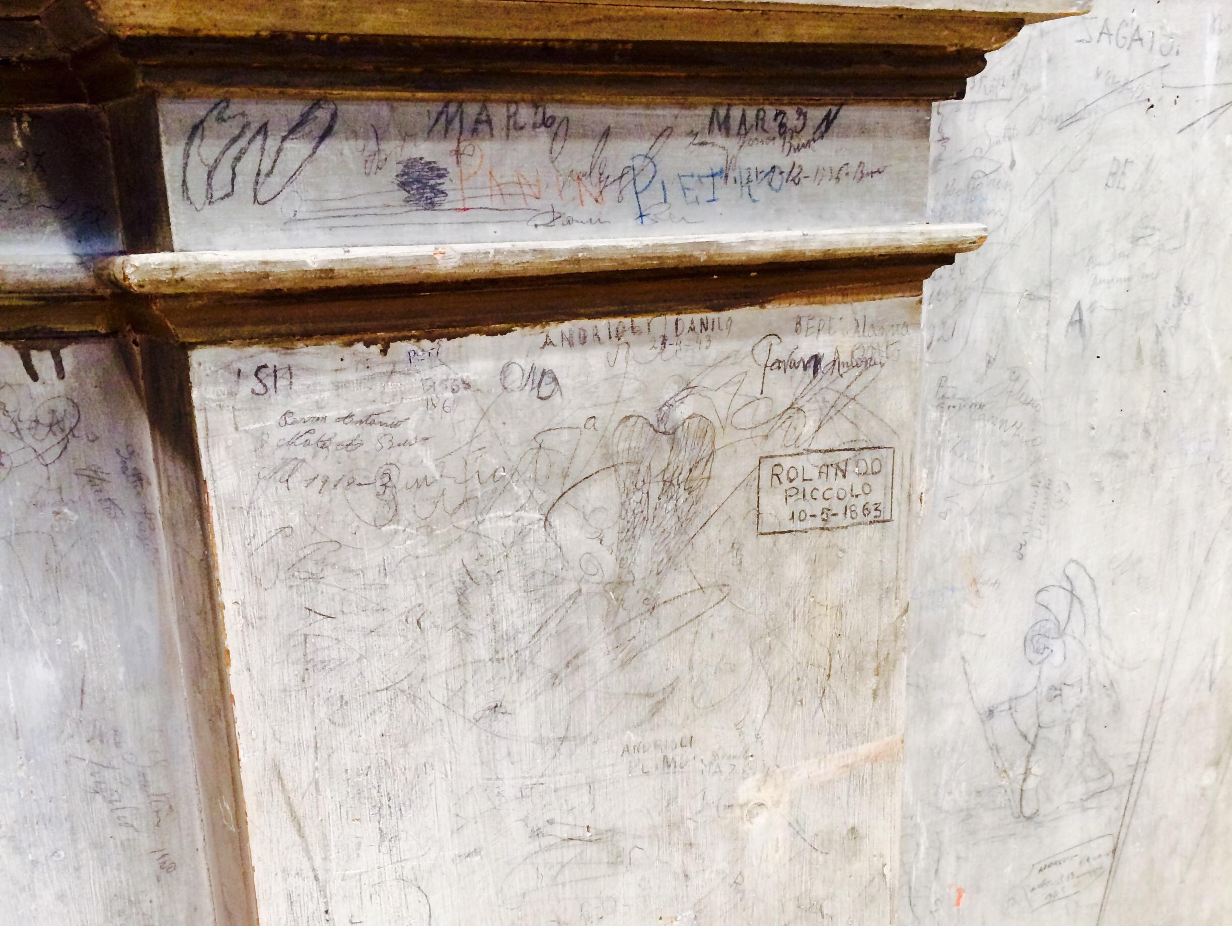 Centuries-old graffiti adorns the case of the historic Italian organ