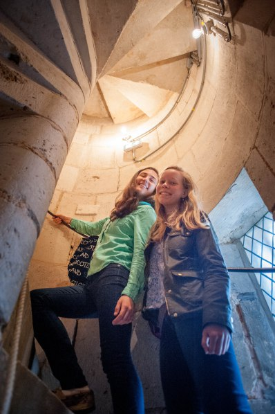 Karen and Laura climb the spiral staircase to the organ balcony
