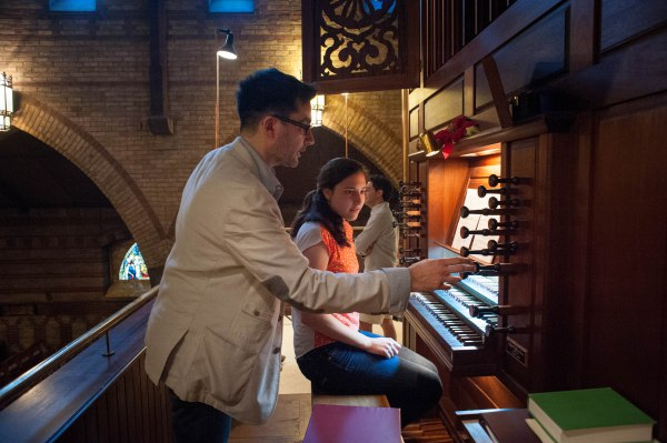 """Karen Christianson """"wowing!"""" us with the Buxtehude Praeludium in E minor, BuxWV 142. Helping with registration is Federico Andreoni, the music director at St. John the Evangelist."""