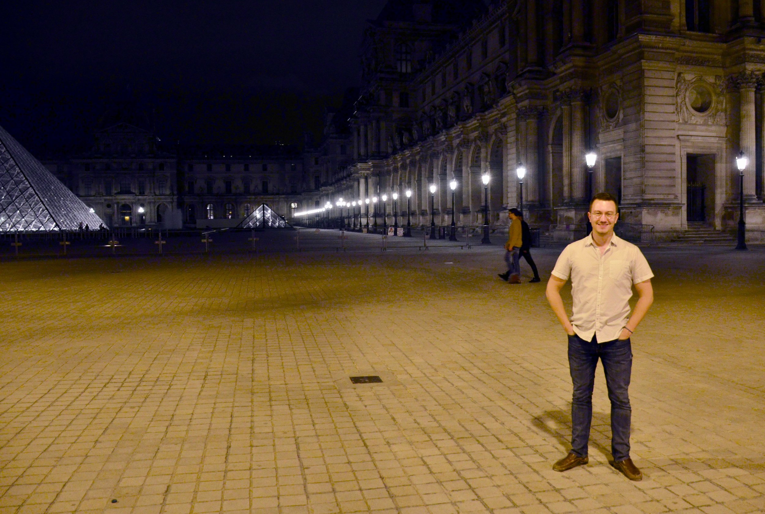 Corey de Tar in front of the Louvre