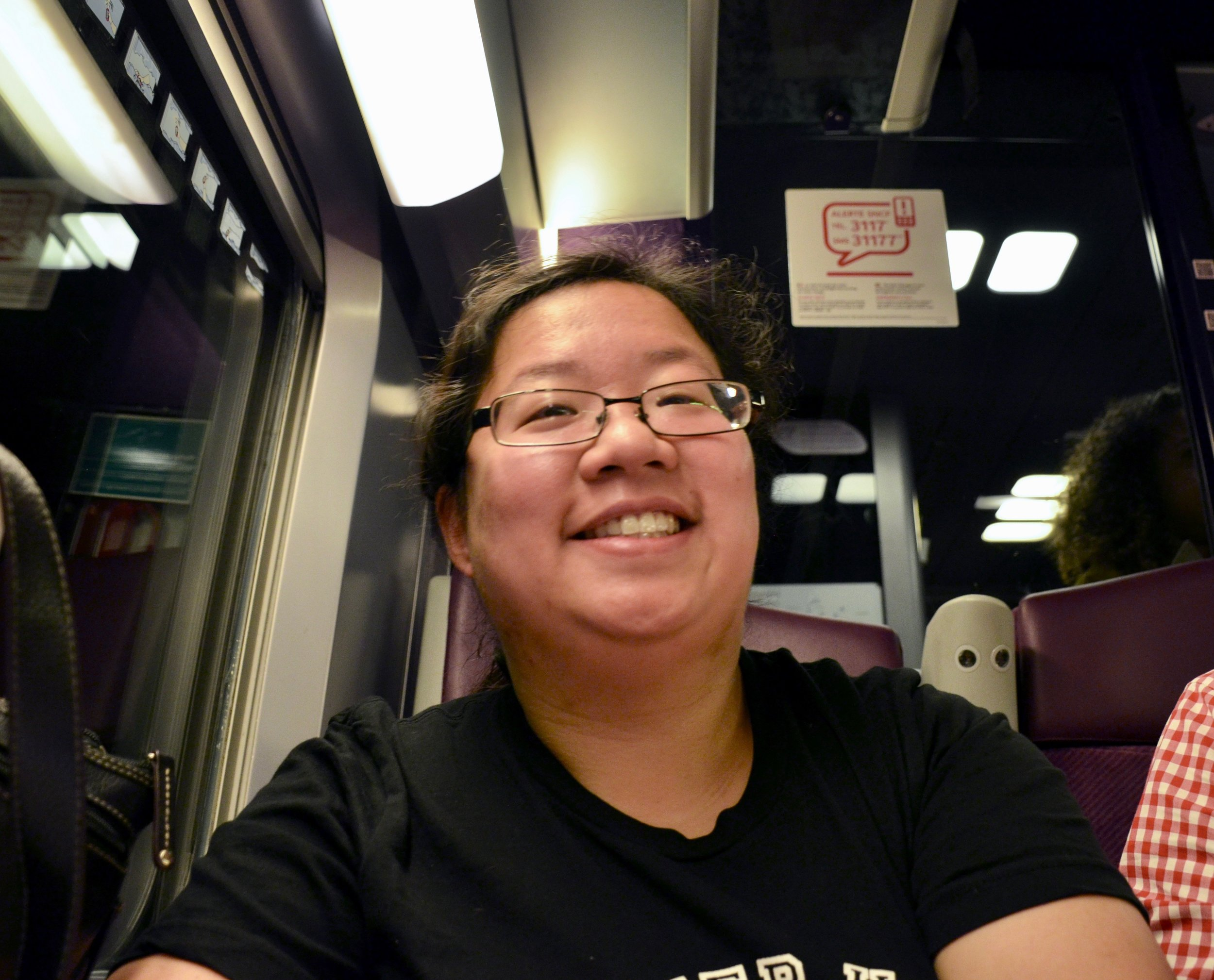 """Jennifer Hsiao is """"all smiles"""" during our long train ride from Paris to Toulouse."""